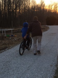 Kevin teaching our youngest son to ride!