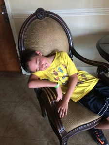 Checking in at Comfort Inn and Suites... kid can sleep ANYWHERE!